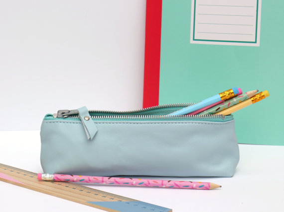 Blue pencil case, £18, Suede and Co.