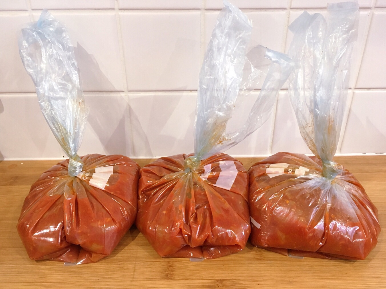 bags of tomato sauce ready for freezing